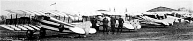 After the 94th Aero Squadron arrived at Koblenz, it painted its SPAD XIIIs in extremely gaudy colors in preparation for flying them to Paris for the French-sponsored pennant presentation ceremony on April 12, 1919. The pilots flew as far as Toul before inclement weather grounded them; they had to complete their trip to Paris by train. (U.S. Air Force photo)