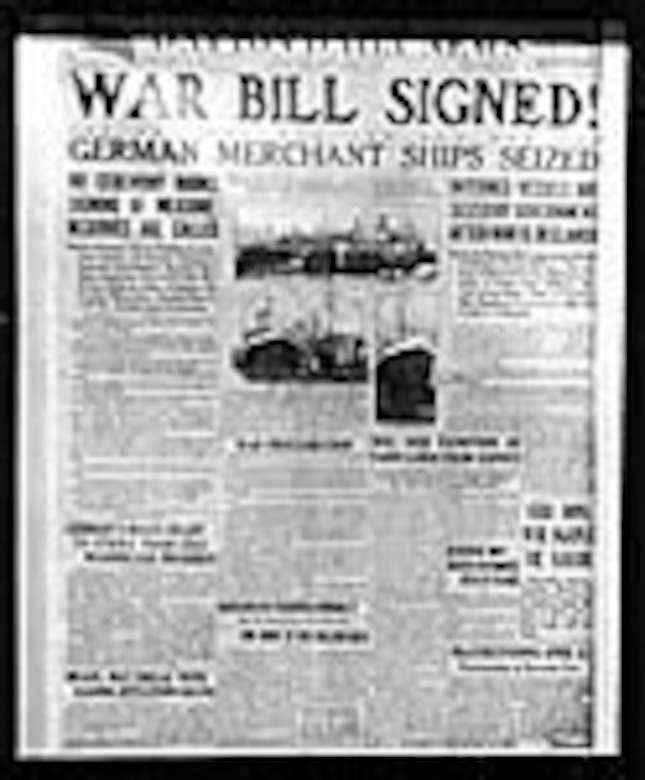 "This newspaper headline reads ""War bill signed: German merchant ships seized."" (U.S. Air Force photo)"