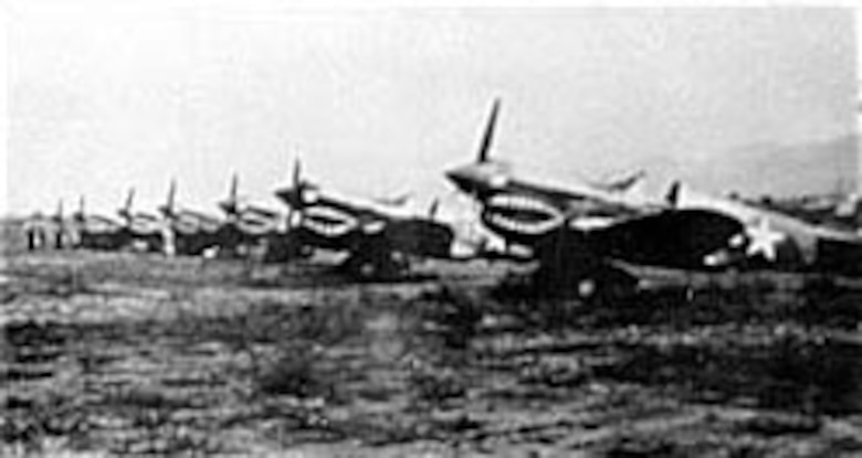 P-40s of the 16th Fighter Squadron as a base in China, October 1942. (U.S. Air Force photo)