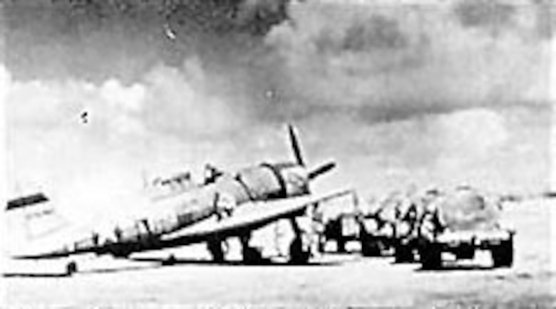 Ground crewmen fuel a P-47 on an airstrip on Saipan prior to its next bombing mission against Japanese positions on nearby Rota Island. (U.S. Air Force photo)