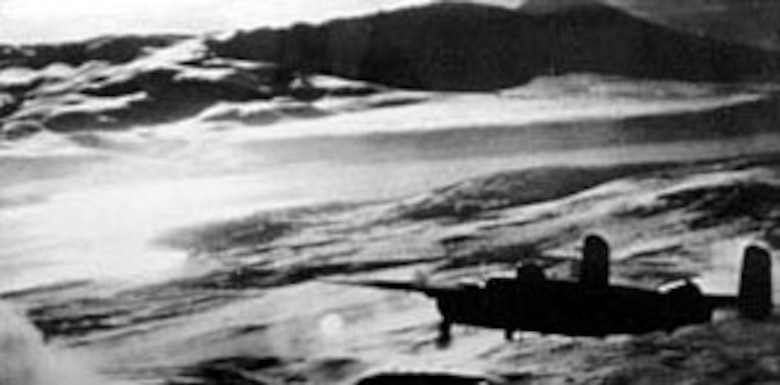An 11th Air Force B-25 based in the Aleutian Islands leads an attack on an enemy convoy near the Kurile Islands. This air strike left six Japanese vessels either sunk or damaged. (U.S. Air Force photo)