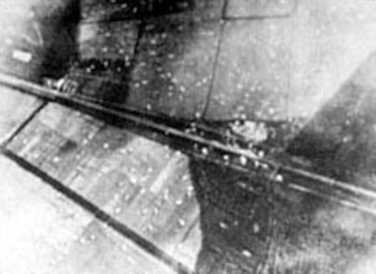 Allied gliders dot the fields adjacent to the highway from Eindhoven to Arnhem in September 1944. (U.S. Air Force photo)