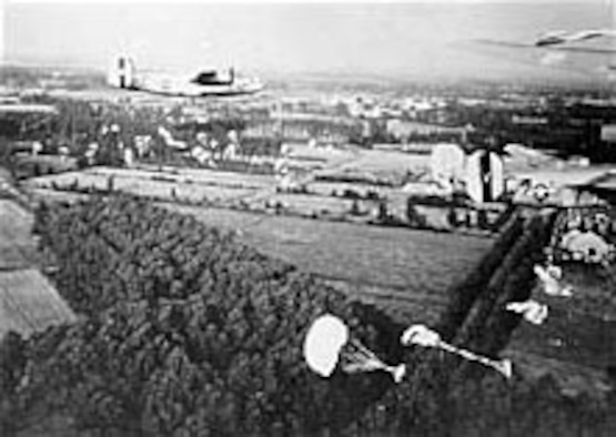 B-24s drop supplies to paratroopers fighting in Holland. (U.S. Air Force photo)