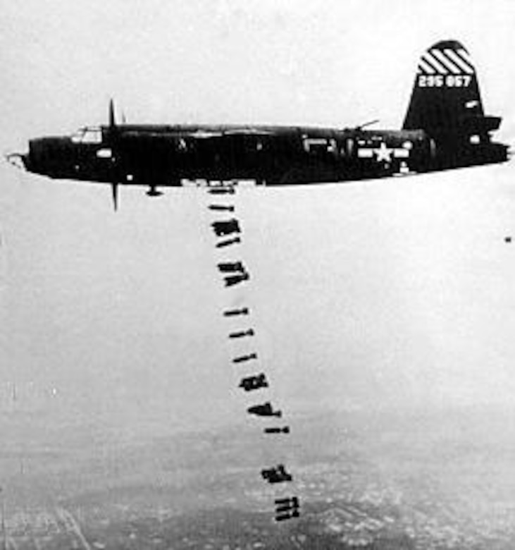 A B-26 drops bombs on a German installation in France. (U.S. Air Force photo)