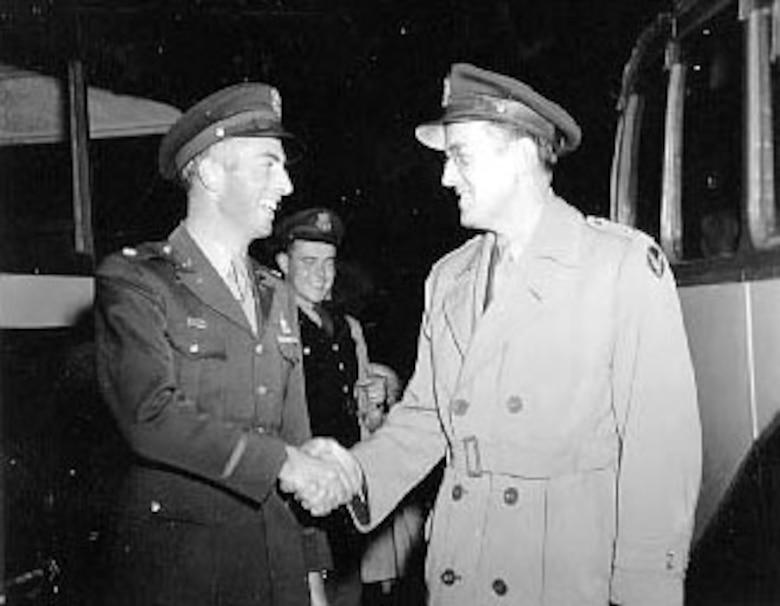 Maj. Glenn Miller greets some soldiers. (U.S. Air Force photo)