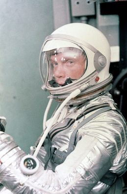 John Glenn prepares for his first space flight. Selected as one of the original seven NASA astronauts, he was the first American to orbit the Earth. (U.S. Air Force photo)