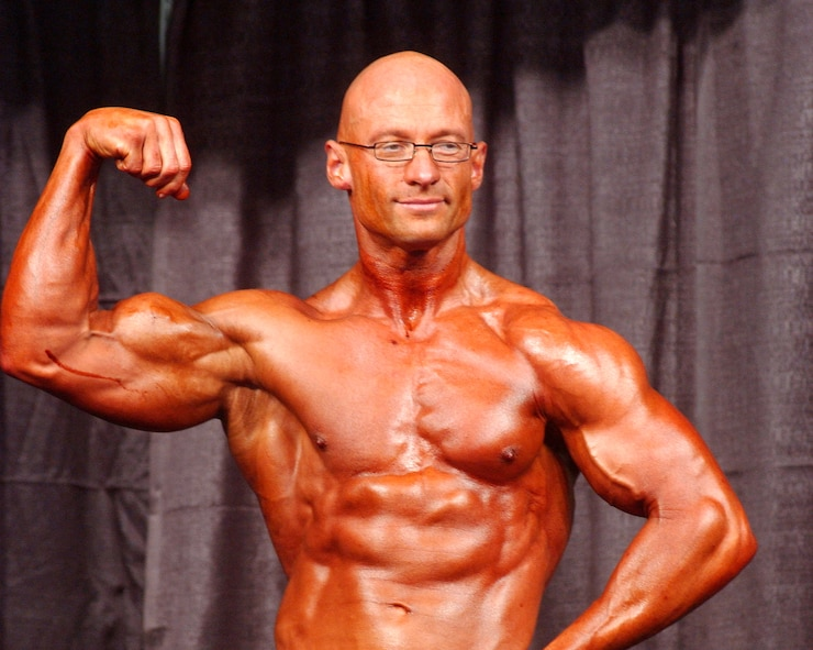 RAMSTEIN AIR BASE, Germany (AFPN) -- Master Sgt. Troy Saunders does a front-bicep pose during the 60-second pose-off at bodybuilding competition here. Sergeant Saunders recently took home the overall title at the 2005 German bodybuilding championships. (U.S. Air Force photo by Christine June)