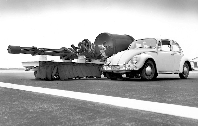 General Electric GAU-8/A displayed next to a Volkswagen Beetle for size comparison. (U.S. Air Force photo)