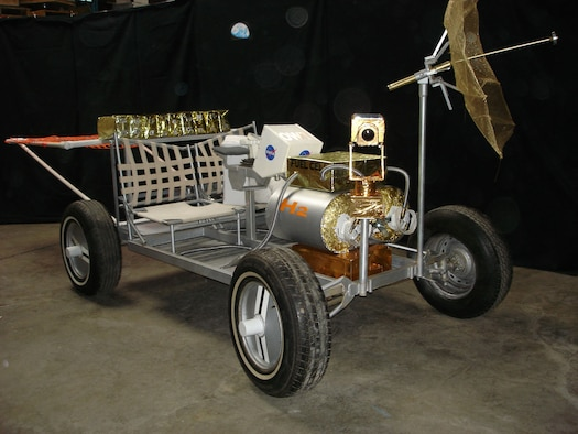 "The ""Blue Moon Inventors"" winning entry, named the ""Off World Truck,"" featured a recharging station mounted on the lunar rover. This mobile recharging station would allow the astronauts on the moon to wear a much lighter and smaller backpack, making moving around and working much less strenuous. (U.S. Air Force photo)"