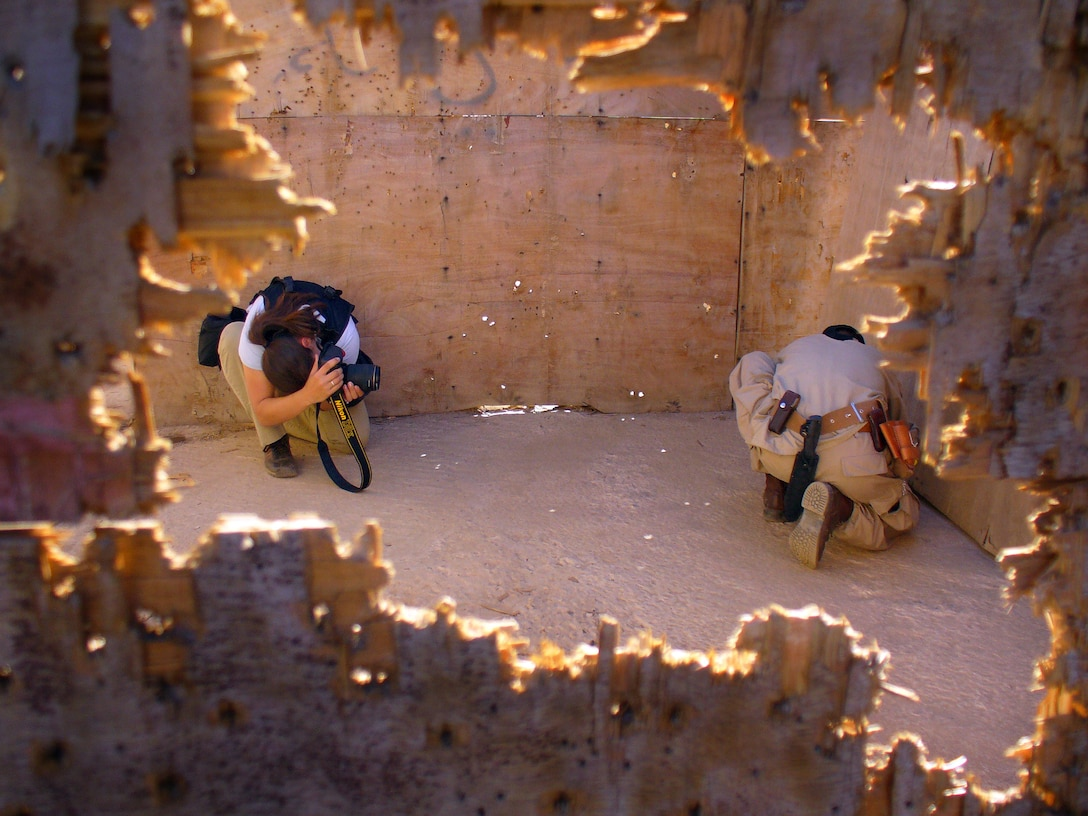 SANA'A, Yemen -- Staff Sgt. Stacy Pearsall documents a Yemeni explosive ordnance disposal technician disabling the blasting cap on a suspicious package during Exercise Western Response training. Sergeant Pearsall is with the 1st Combat Camera Squadron at Charleston Air Force Base, S.C.  (U.S. Air Force photo by Capt. Charles Rohrig)