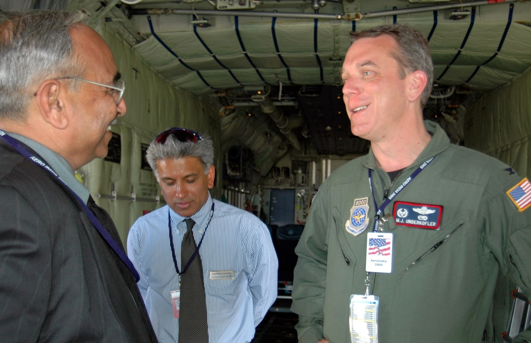 BANGALORE, India -- Col. Michael Underkofler (right) leads the tour of a C-130J Hercules during the Aero India International Air Show here Feb. 9.  The display included Navy P-3C Orions, KC-135 Stratotankers and F-15 Eagles.  Colonel Underkofler is the commander of the 403rd Operations Group.  (U.S. Air Force photo by Lt. Col. Mike Odom)