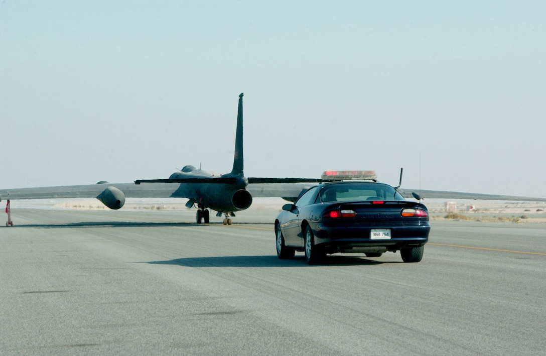 SOUTHWEST ASIA -- A Chevrolet Camaro Z-28 chases a U-2 Dragon Lady down the runway here.  Because of visibility limitations when on the ground, U-2 pilots rely on the driver in the car to provide information during takeoffs and landings.  (U.S. Air Force photo by Staff Sgt. Justin Jacobs)
