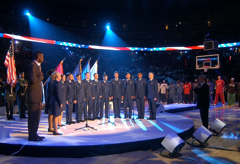 DENVER -- The U.S. Air Force Academy Cadet Chorale and David Robinson, a retired San Antonio Spur and a 1987 Naval Academy graduate, sing the national anthem at the 2005 NBA All-Star Game here Feb. 20. The cadet chorale's visit was part of the NBA's salute to the men and women of the armed forces. (U.S. Air Force photo by Staff Sgt. Steve Grever)