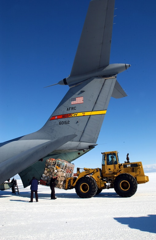 MCMURDO STATION, Antarctica -- Cargo is unloaded from a C-141 Starlifter from March Air Reserve Base, Calif., on the ice runway near here.  The crews and aircraft were flying the last Air Force Reserve mission to Antarctica supporting Operation Deep Freeze.  (U.S. Air Force photo by Tech. Sgt. Joe Zucarro)