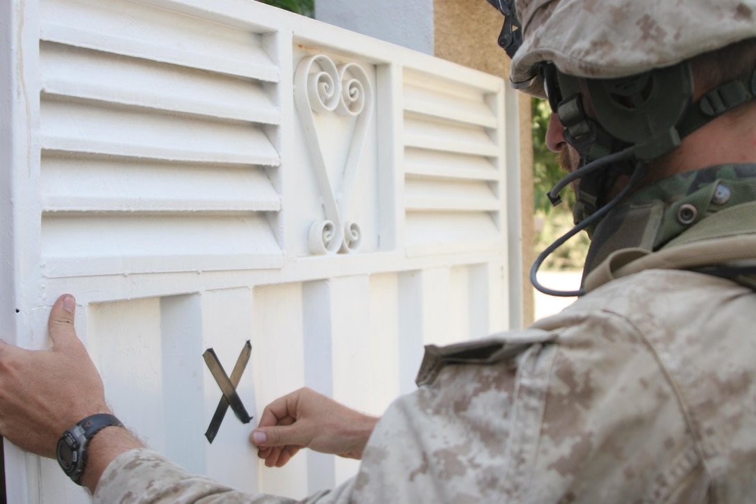HIT, Iraq (July 1, 2005)- Sgt. James Angelone, a squad leader with 3rd Battalion, 25th Marine Regiment, Regimental Combat Team-2 marks a house during a patrol and cordon and knock in the city during Operation Guardian Sword conducted to clear the city and set-up Iraqi Security Forces firm bases through out the city. The Marines of 2d Marine Division conduct counter-insurgency operations with Iraqi Security Forces to isolate and neutralize anti-Iraqi forces, to support the continued development of Iraqi Security Forces, and to support Iraqi reconstruction and democratic elections in order to create a secure environment that enables Iraqi self-reliance and self-governance. (Official USMC photo by Lance Cpl. Lucian Friel )(NOT RELEASED)