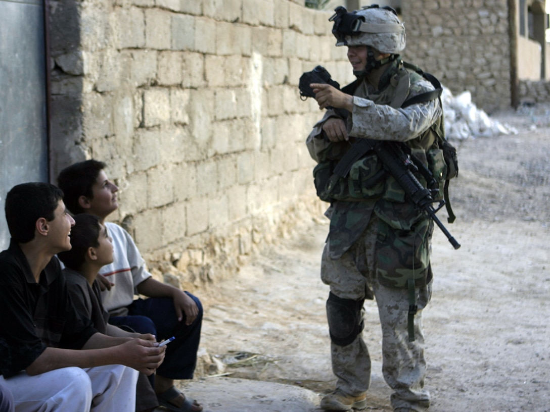 Haqlaniya, Al Anbar, Iraq (May 1, 2005)-- Lance Cpl. Ruben Marinelarena, 25 of Sante Fe, NM., and a n infantry man with 3rd battalion, 25th Marine Regiment, who has been praticing his Arabic speaking skillsand tries to speakwith the local people where ever he goes.(Official USMC Photo by Corporal Ken Melton)