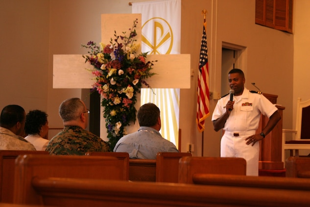 Chaplain Dwayne Jackson, staff chaplain, Marine Aircraft Group 31, addresses a crowd gathered to observe the National Day of Prayer May 5 at the Air Station Chapel.