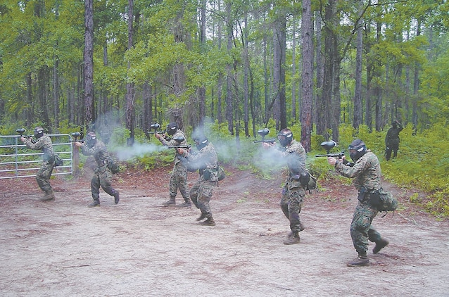 Corporal's School class 4-05 wore their battle colors when they carried out a paintball war as part of their field training, May 6, aboard the Air Station.