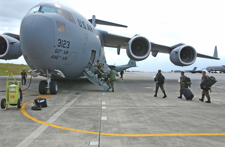 KADENA AIR BASE, Japan -- A team from several squadrons here board a C-17 Globemaster III for a 45-day deployment to Sri Lanka.  The team deployed as part of disaster relief following the 9.0 magnitude earthquake that struck off the coast of Indonesia causing tsunami waves that have affected 12 countries and has killed more than 150,000 people. The 18th Wing is providing relief supplies and personnel to help with the humanitarian effort. The team is composed of Airmen form the base's 718th Aircraft Maintenance Squadron, 33d Aircraft Maintenance Unit, 33rd Rescue Squadron, 18th Logistics Readiness Squadron, and 18th Maintenance Squadron. (U.S. Air Force photo by Airman 1st Class Michael Pallazola)