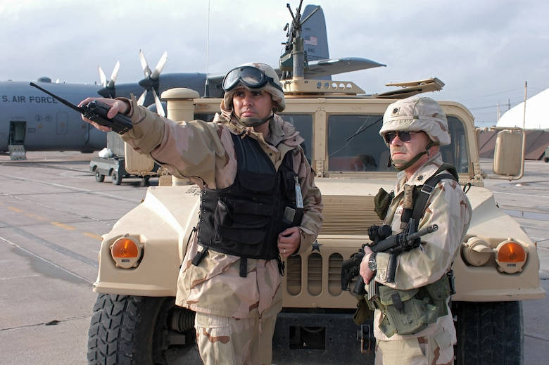 KARSHI-KHANABAD AIR BASE, Uzbekistan -- Staff Sgt. Robert Polanco shows Lt. Col. Donald Klinko areas where the security forces are guarding the flightline.  Sergeant Polanco is assigned to 416th Expeditionary Mission Support Squadron's security forces flight.  Colonel Klinko is the squadron's commander.  (U.S. Air Force photo by Senior Airman Matt Rosine)