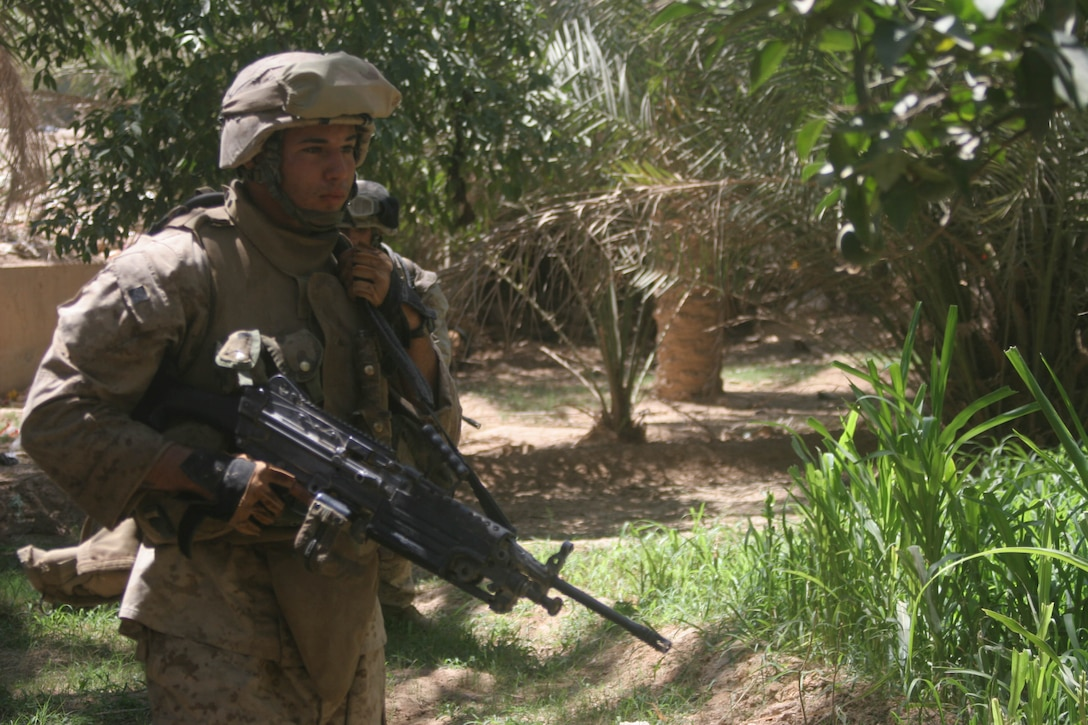 BANI DAHRI, Iraq (July 13, 2005)- Lance Cpl. Raphael P. Ramos, 21, from Carolina, Puerto Rico and a squad automatic weapon gunner with 1st Squad, 3rd Platoon, Company K, 3rd Battalion, 2nd Marine Regiment, Regimental Combat Team-2 patrols through a wadie in the city during Operation Quick Strike. The 2003 Ana Roque High School graduate is making his first deployment in support of Operation Iraqi Freedom and has decided to continue his career and become a Marine Corps officer. (Official USMC photo by Lance Cpl. Lucian Friel )(RELEASED)