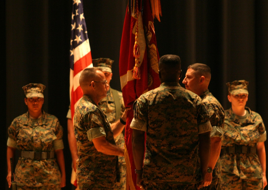 MARINE CORPS BASE CAMP LEJEUNE, N.C. (Sept. 8, 2005) -  Family, friends and colleagues were present as Honolulu native, Col. Thomas L. Cariker relinquished command of 10th Marine Regiment, 2nd Marine Division, to Lt. Col. Christopher Mayette of South Bend, Ind., at a change of command ceremony here Sept. 9.