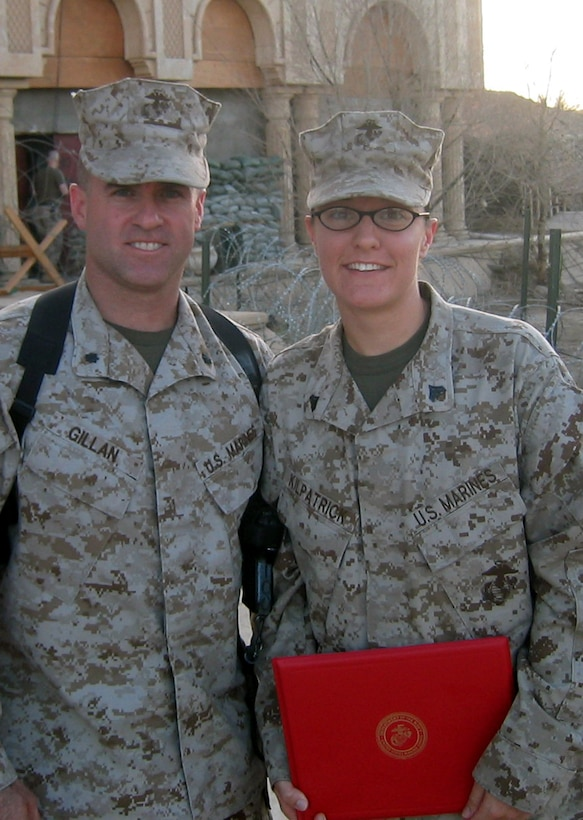 CAMP BLUE DIAMOND, AR RAMADI, Iraq -- Corporal Melissa Kilpatrick, an intelligence analyst with the 2nd Marine Division, poses with her boss LtCol. Andrew Gillan, for a photo with her newly awarded Navy and Marine Corps Achievement Medal certificate for her work in Operation Iraqi Freedom.