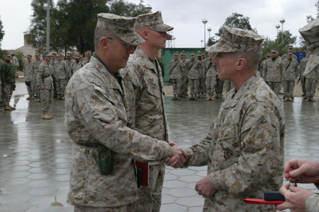 Major General Huck shakes hands with Chief Warrant Officer David R. Dunfee for recieving the Silver Star Award on March 10, 2005.