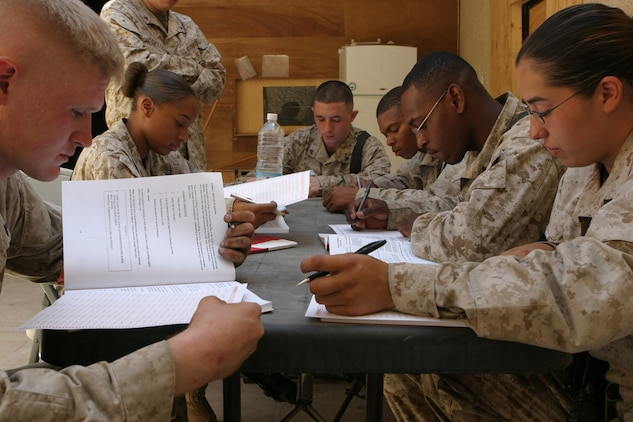 CAMP BLUE DIAMOND, AR RAMADI, Iraq - Marines with Truck Company, Headquarters Battalion, 2nd Marine Division, study together in the new Commander's Library, which was created this month to expedite professional learning and promotion for Marines deployed here.  The library, located in the Truck Company dispatch office, strictly contains Marine Corps Institute books used by Marines to learn and brush up on everything from basic infantry and leadership skills to writing essays and using proper grammar.  U.S. Marine Corps photo by Sgt. Stephen D'Alessio (RELEASED)