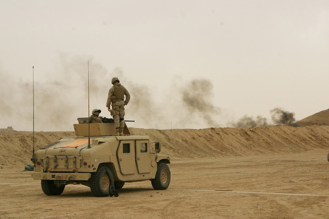 CAMP RAMADI, AR RAMADI, Iraq - Marines with Truck Company, Headquarters Battalion, 2nd Marine Division, hit targets from their humvee during a live fire and maneuver exercise, May 12, designed specifically to combat the insurgency.  U.S. Marine Corps photo by Sgt. Stephen D'Alessio (RELEASED)