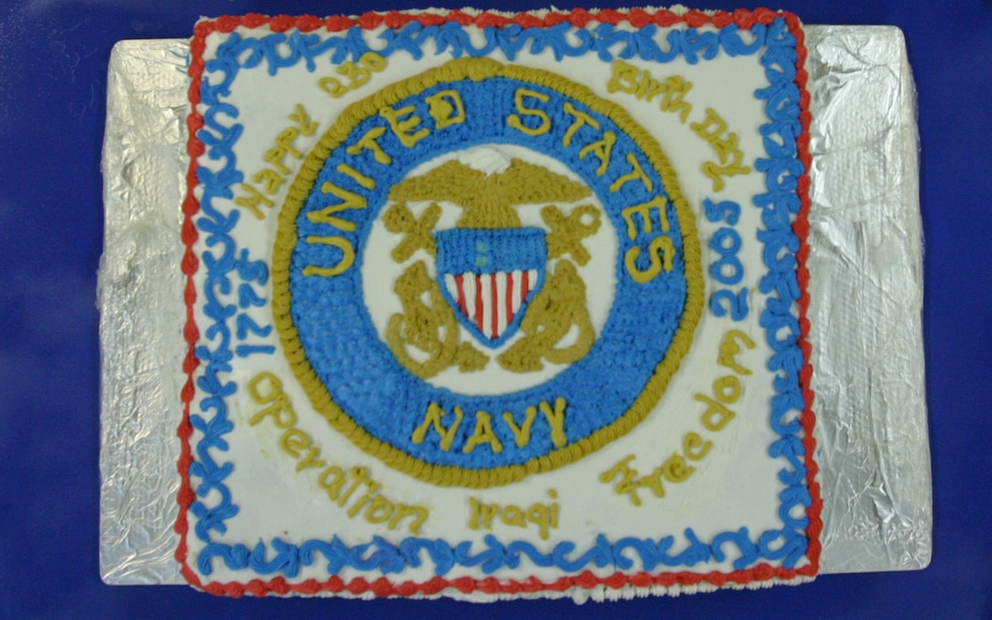 CAMP BLUE DIAMOND, AR RAMADI, Iraq - Civilian employees at the chow hall here made this cake for the Navy's 230th birthday which was celebrated in a ceremony Oct. 13.