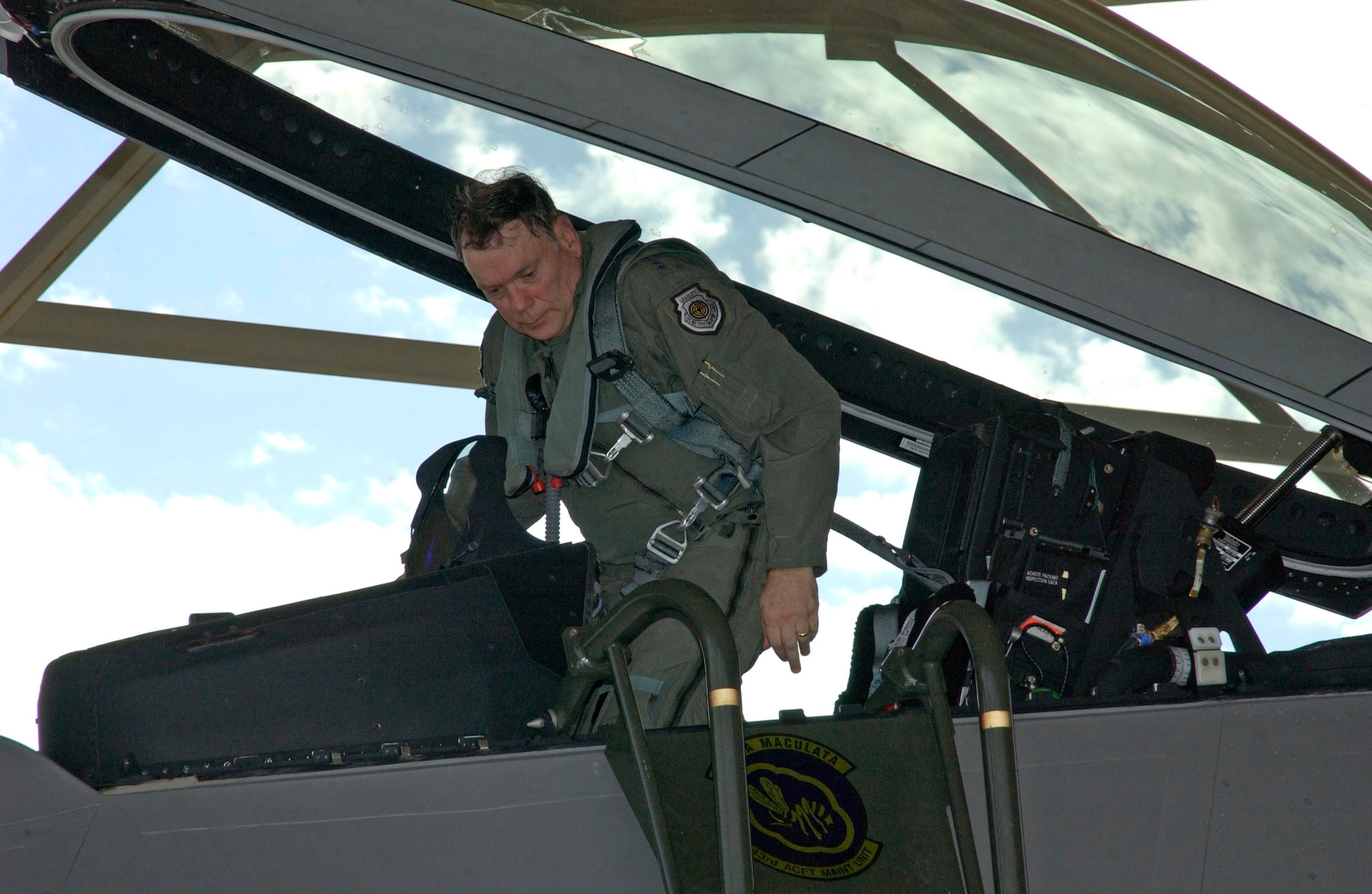 TYNDALL AIR FORCE BASE, Fla. -- Air Force Chief of Staff Gen. John P. Jumper exits an F/A-22 Raptor following his qualification flight here.  The general said he participated in a 2-week qualification training program in the Raptor so he could speak with authority on the program's importance.  (U.S. Air Force photo by Lisa Norman)