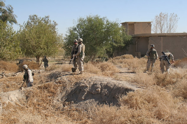 051114-M-2607O-003 - Combat engineers attached to Company F, 2nd Battalion, 2nd Marine Regiment, search a village on the first day of Operation TRIFECTA looking for weapons caches.