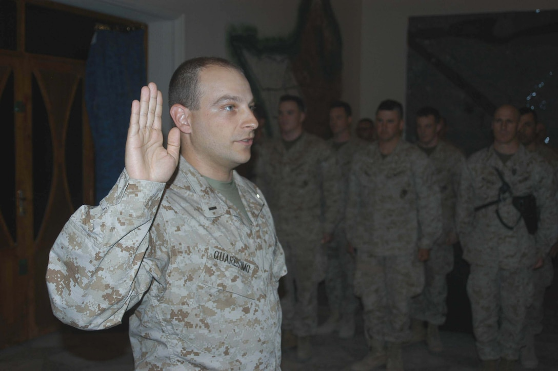 CAMP HURRICANE POINT, Ar Ramadi, Iraq (April 16, 2005) -Navy Lt. j.g Mike A. Quaresimo, information operations officer, Information Operation, Headquarters and Service Company, 1st Battalion, 5th Marine Regiment, holds up his right hand and takes his oath of office during a promotion ceremony here. The 32-year-old from Poughkeepsie, N.Y., was promoted to the rank of Navy lieutenant in front of more than 30 service members with the infantry battalion who attended to honor him on his day of advancement. Quaresimo volunteered to accompany warriors with 1st Battalion, 5th Marines on their deployment to Ar Ramadi in support of Operation Iraqi Freedom. Photo by Cpl. Tom Sloan