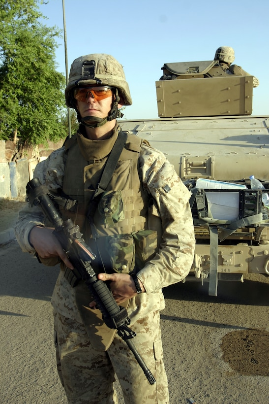 FALLUJAH, Iraq - Corporal Mychal McVicker, an infantryman with 2nd Combined Anti-Armor Team, Weapons Company, 1st Battalion, 6th Marine Regiment, provides security outside his vehicle while other battalion infantrymen patrol the city streets Sept. 17.  The 22-year-old Elizabeth City, N.C. native and his teammates have been providing outer perimeter security during hundreds of patrols, raids and house-to-house search missions since arriving here in mid-March.