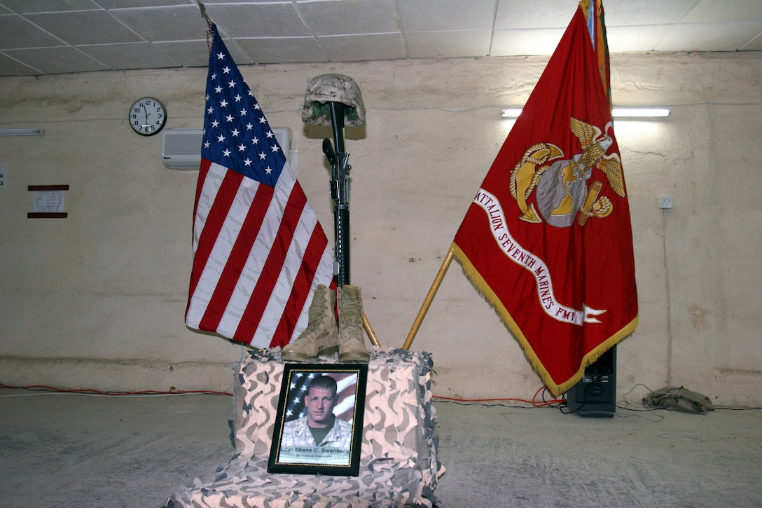 050918-M-8489S-001 AR RAMADI, Iraq (September 18, 2005) - The memorial for Lance Cpl. Shane Swanberg, who died Sept. 15 from indirect fire. Photo by Cpl. Shane Suzuki
