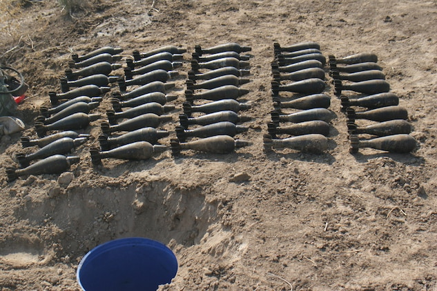 051117-M-2607O-002 - A large number of 82 millimeter mortars were discovered in blue plastic buckets buried in the ground along a canal during Operation TRIFECTA on Nov 17.