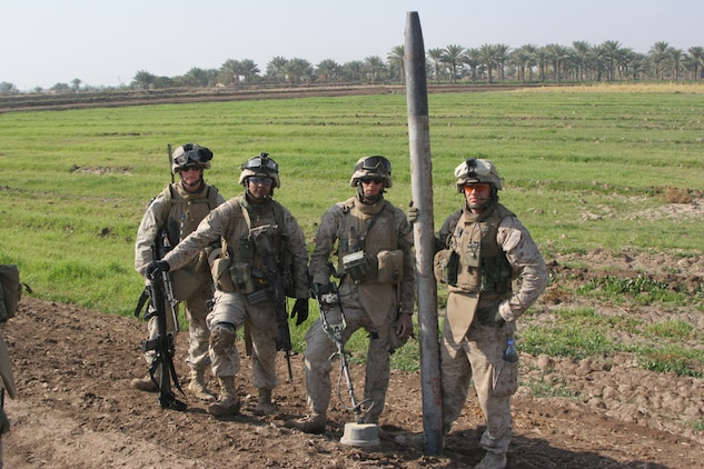 051117-M-2607O-003 - Engineers stand tall with their even taller rocket discovered next to a small canal while conducting cache sweeps during Operation TRIFECTA on Nov 17.