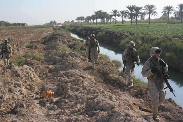 051117-M-2607O-005 - Engineers patrol along a canal while conducting cache sweeps of a burm during Operation TRIFECTA on Nov 17.