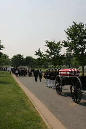 Cpl. Micah Snead Lt. Col. John C. Spahr's funeral procession moves through Arlington National Cemetery, May 18. Spahr, a 42-year-old Cherry Hill, N.J. native, died May 2, from injuries received when he F/he was piloting was involved in an aircraft mishap.