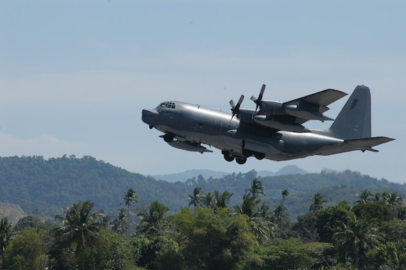 LANGKAWI, Malaysia -- An MC-130P Combat Shadow from Kadena Air Base, Japan, takes off from here Jan 14.  Crews from Kadena's 17th Special Operations Squadron fly into Indonesia daily, shuttling humanitarian relief supplies into Banda Aceh.  (U.S. Air Force photo by Master Sgt. Michael Farris)