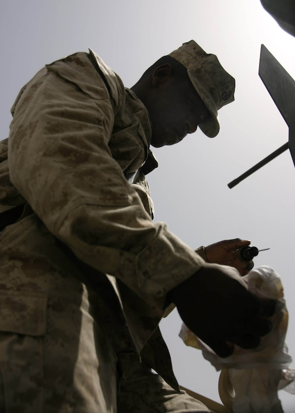 Haditha, Al Anbar, Iraq (May 21, 2005) - Motor transportation operator with 3rd Battalion, 25th Marine Regiment, Cpl. Clifton C. Watkins, a 22-year-old McComb, Miss., native, checks the fluids in his vehicle before he goes out on his next mission.  (Official USMC photo by Cpl. Ken Melton)