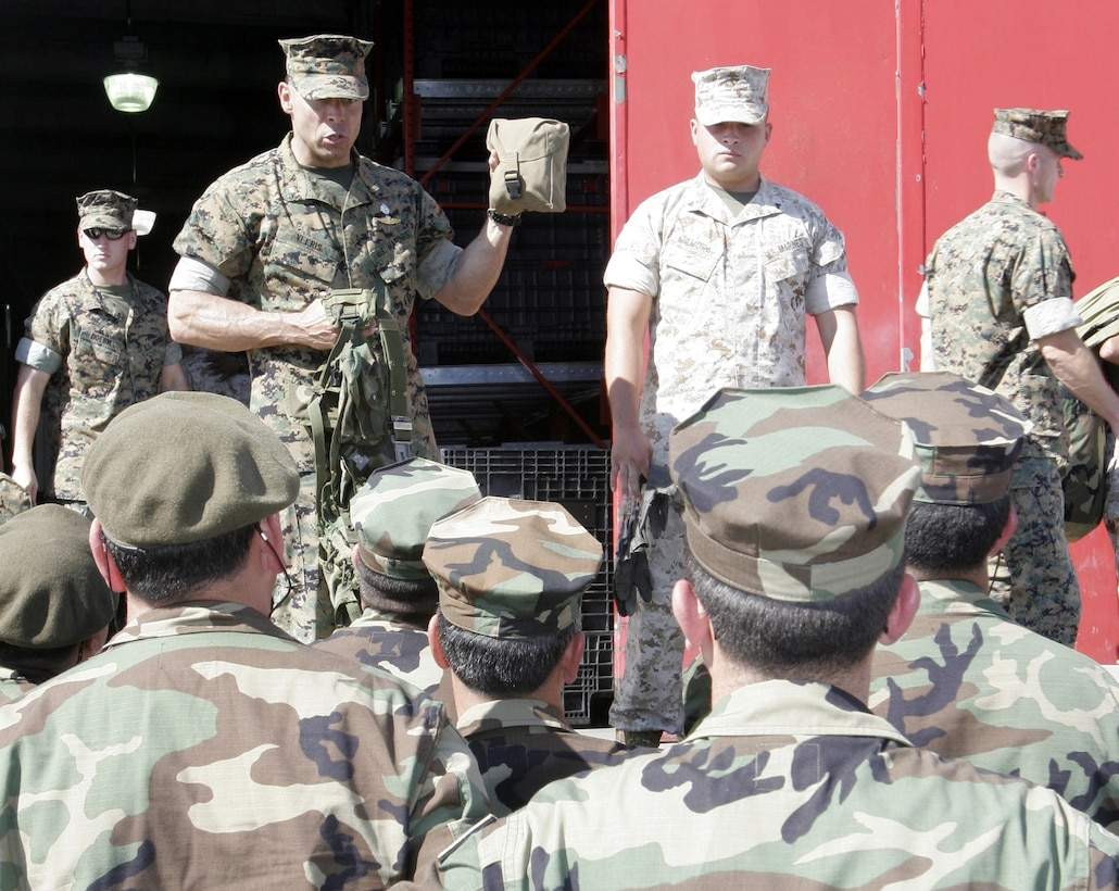 Maj. Christian H. Veeris, Chile exchange officer, Marine Forces South, explains the Improved First Aid Kit to Chilean marines from the Chilean Amphibious Brigade. The Chileans are here as participants in the annual Centauro Exchange Program, the purpose of which is to foster close international relations and build a joint sense of esprit de corps, said 10th Marines commanding officer Lt. Col. Christopher T. Mayette.