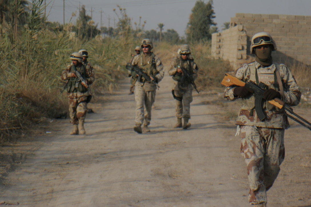 011120-M-2607O-001 - Marines and Iraqi Army Soldiers patrol the streets around Al Karmah, Iraq, in preparation for a night raid on an expected insurgent's house Nov. 20.