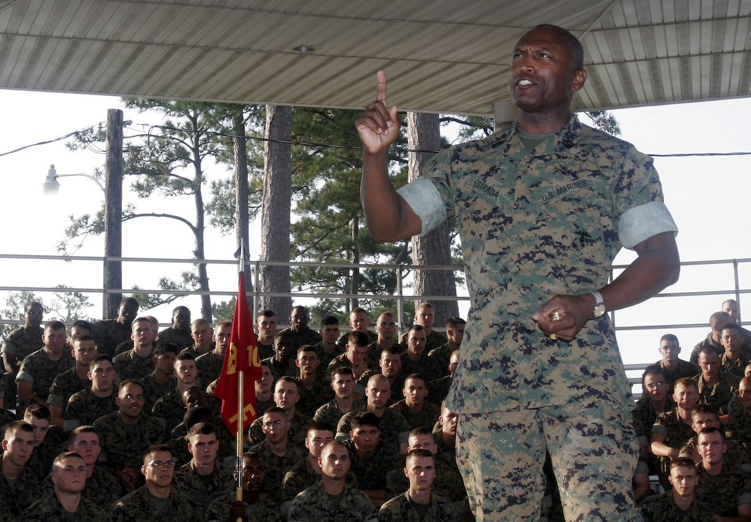 Sergeant Major of the Marine Corps Sgt. Maj. John L. Estrada addresses Marines from 10th Marine Regiment on the occasion of his visit here October 21. Estrada stressed the importance off-duty safety to the leathernecks, speaking about the tragedy of surviving combat only to face injury or death on liberty at home. Estrada discussed specific such as wearing seatbelts, drunk driving and motorcycle safety.