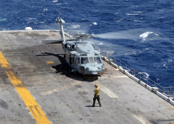 ABOARD USS PELELIU (LHA-5), (Sept. 29, 2008)- A MH-60S Seahawk helicopter prepares to take off from the flight deck of USS Peleliu during a vertical replenishment, Sept. 29. Vertical replenishments are designed to resupply a Peleliu using helicopters to transport supplies from one ship to another.::r::::n::The Camp Pendleton, Calif., based 15th MEU is embarked aboard USS Peleliu and is comprised of approximately 2,200 Marines and Sailors and is a forward deployed force in readiness capable of conducting numerous operations, such as Non-Combatant Evacuation Operations, Humanitarian Assistance Operations and range of amphibious missions.  The MEU is currently deployed aboard USS Peleliu (LHA-5), USS Dubuque (LPD-8) and USS Pearl Harbor (LSD-52).   (Official USMC photo by Cpl Stephen Holt)::r::::n::