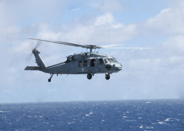 ABOARD USS PELELIU (LHA-5), (Sept. 29, 2008)- A MH-60S Seahawk helicopter maneuvers into position during a vertical replenishment, Sept. 29. Vertical replenishments are designed to resupply a Peleliu using helicopters to transport supplies from one ship to another.::r::::n::The Camp Pendleton, Calif., based 15th MEU is embarked aboard USS Peleliu and is comprised of approximately 2,200 Marines and Sailors and is a forward deployed force in readiness capable of conducting numerous operations, such as Non-Combatant Evacuation Operations, Humanitarian Assistance Operations and range of amphibious missions.  The MEU is currently deployed aboard USS Peleliu (LHA-5), USS Dubuque (LPD-8) and USS Pearl Harbor (LSD-52).   (Official USMC photo by Cpl Stephen Holt)::r::::n::