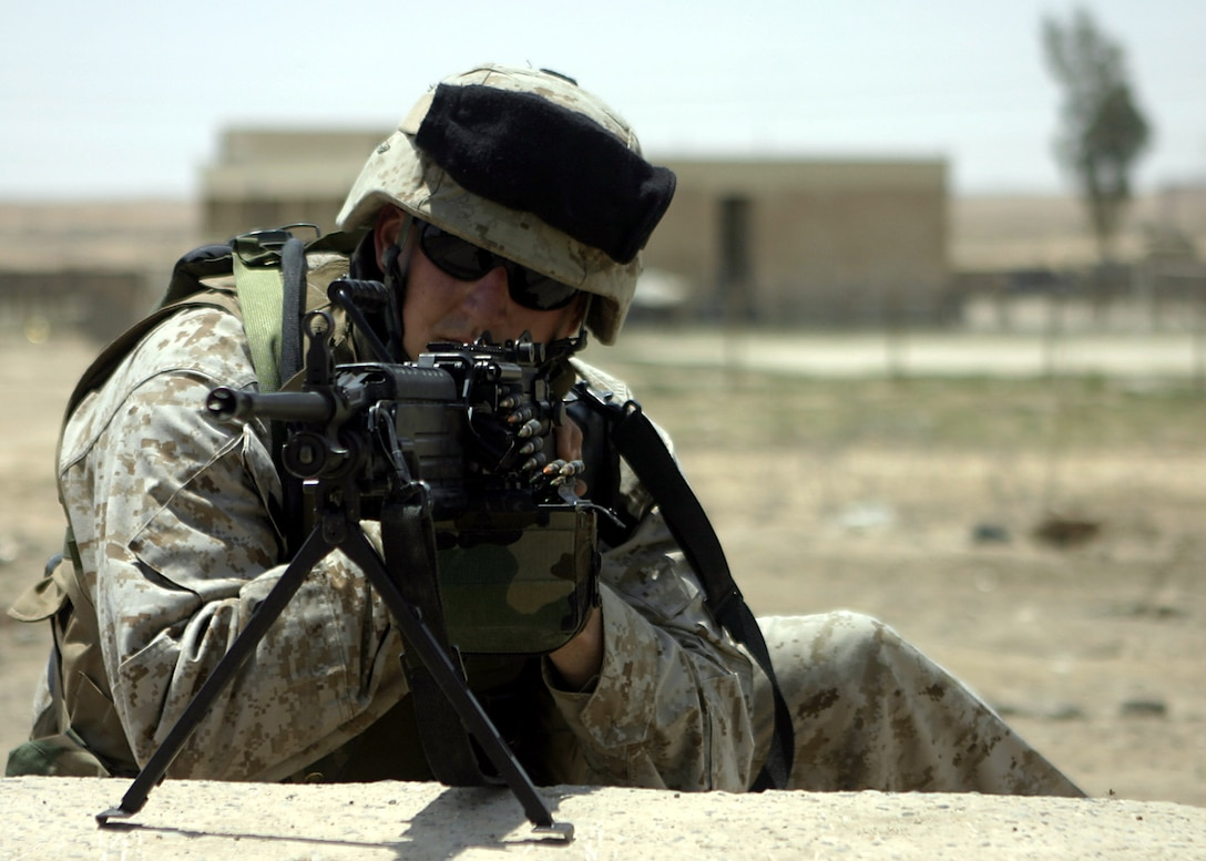 Haditha Dam, Al Anbar, Iraq (May 4, 2005)-- Cpl. Brian P. Montgomery, a 26-year-old Willoughby, Ohio native and a scout sniper with Team America, 3/25 Weapons Co., keeps eyes on potentially dangerous threats.(Official USMC Photo by Corporal Ken Melton)