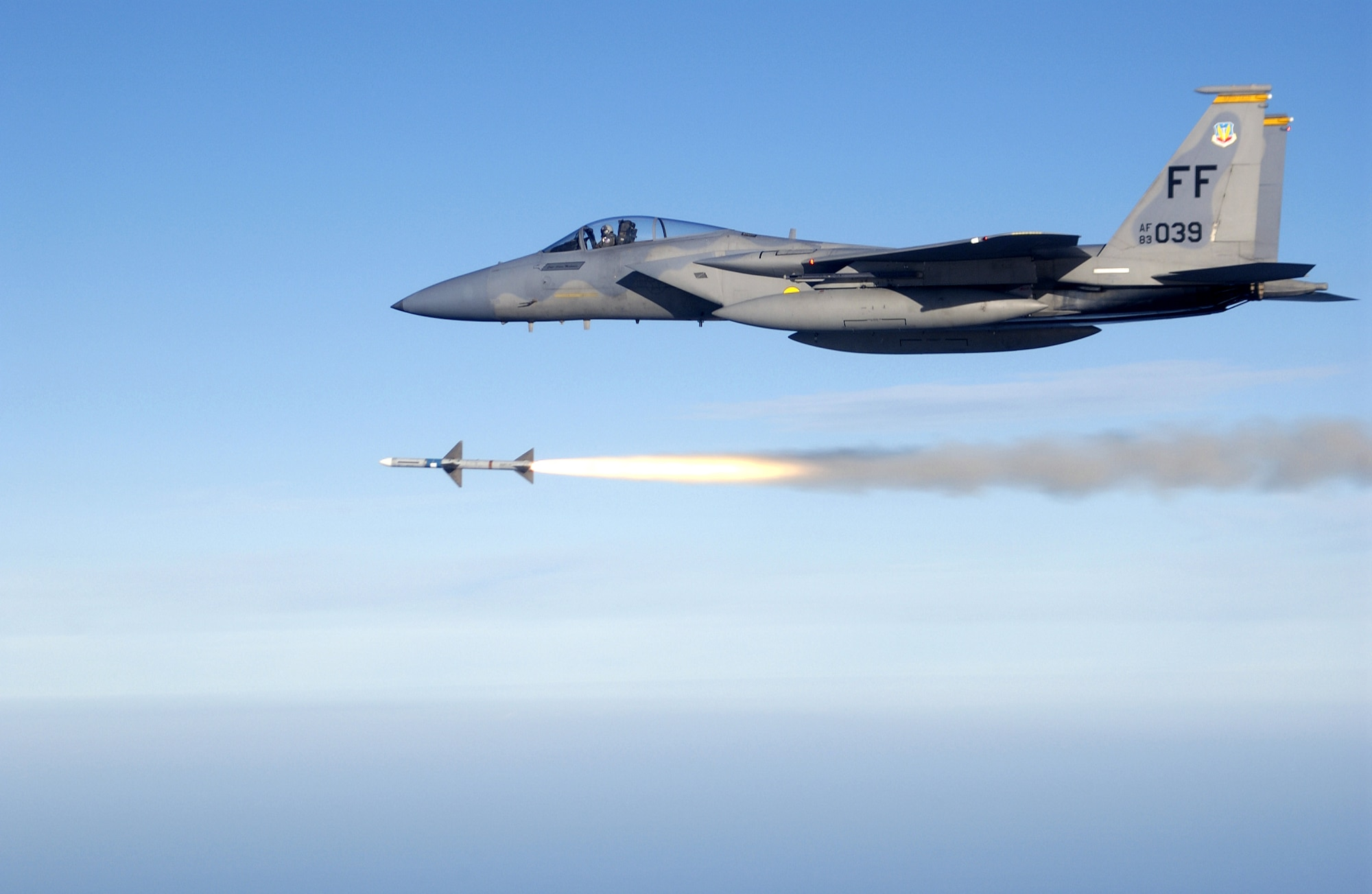 OVER THE GULF OF MEXICO -- First Lt. Charles Schuck fires an AIM-7 Sparrow medium range air-to-air missile from an F-15 Eagle here while supporting a Combat Archer air-to-air weapons system evaluation program mission.  He and other Airmen of the 71st Fighter Squadron deployed from Langley Air Force Base, Va., to Tyndall AFB, Fla., to support the program.  (U.S. Air Force photo by Master Sgt. Michael Ammons)