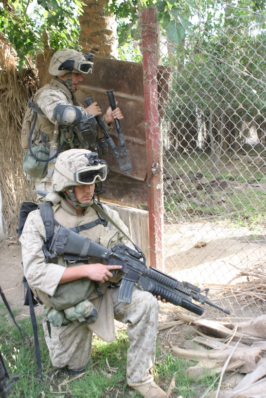 HADITHA, Iraq (May 25, 2005)- Marines with 3rd Squad, 3rd Platoon, Company K, 3rd Battalion, 2nd Marine Regiment, Regimental Combat Team-2 cut their way through obstacles using their breaching kit during a sweep of northern Haditha. Kilo Co. was supporting 3rd Bn., 25th Marines during Operation New Market to clear the city. (Official U.S. Marine Corps photo by Lance Cpl. Lucian Friel (RELEASED)